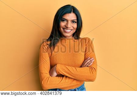 Young latin transsexual transgender woman wearing casual clothes happy face smiling with crossed arms looking at the camera. positive person.