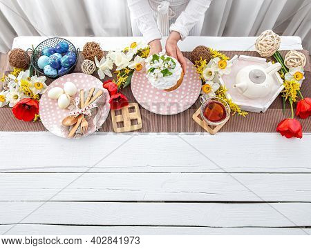 Table Setting For The Easter Holiday. Tea, Homemade Cake, Eggs And Flowers On A Wooden Table Copy Sp