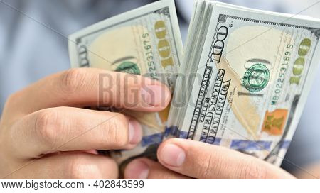 Businessman Hands Counting Cash Dollars. Finance And Money Payment Concept.
