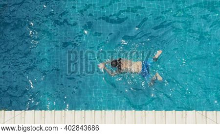 In Summer Sunny Day Swimming Pool Blue Color Clear Water And People Enjoying