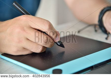 Designer Hands Drawing On Digital Graphic Tablet In Home Office. Remote Work And Design Concept. Clo