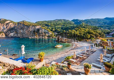 Corfu, Greece. Agios Petros Beach In The Village Of Paleokastritsa.