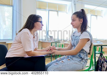 Woman School Psychologist Talking And Helping Student, Teenage Girl. Mental Health Of Adolescents, P