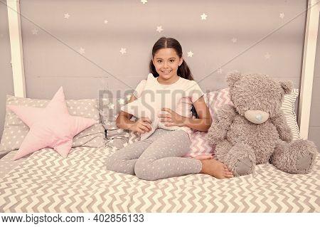 Tidy Bedroom. Cute Cozy Bedroom For Small Girl. Girl Having Fun Bedroom Interior. Childhood Concept.