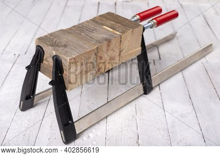 Joiner Clamp For Gluing Wood. Carpentry Accessories In The Workshop.