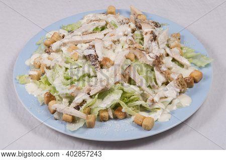 Chicken Cesar Salad On A White Background