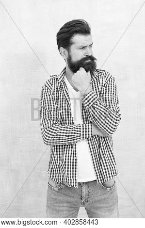 Lost In Thoughts. Serious Look Of Bearded Man. Serious Hipster With Beard Blue Background. Solving P