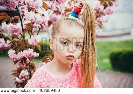 Spring Blossom. Beautiful Teenager Girl Enjoying Life In Spring Blossoming Garden. Girl In Blossom G