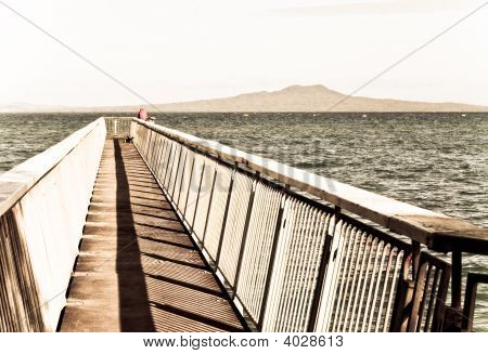 Fishing On A Beach Pier.Aged Photo Style.