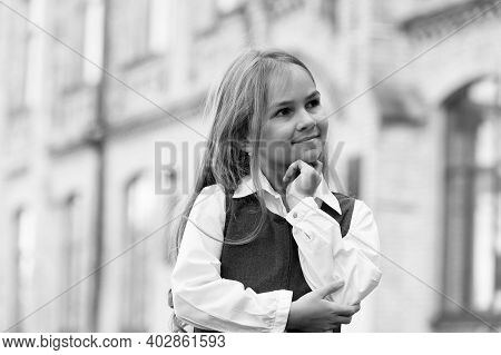 Happy Little Child Lost In Thoughts With Thoughtful Look In School Uniform Outdoors, Thinking.
