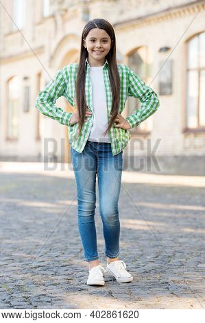 Casual Look. Little Kid Keep Hands On Hips Outdoors. Wearing Casual Style. Trendy Childrens Wear. Fa