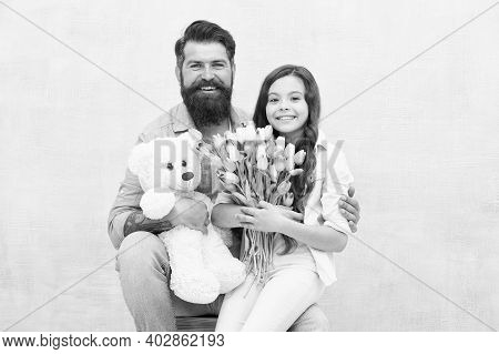 Happy Womens Day. Happy Family Celebrate Womens Day. Bearded Man And Little Child Hold Flowers And T