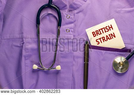 Covid-19 British Strain Symbol. Medical Uniform, White Card With Words 'british Strain', Metalic Pen