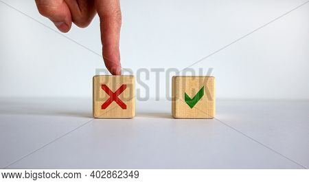 Yes Or No Choice Symbol. Hand Making A Choice Between Two Cubes With Yes And No Icon On Beautiful Ne