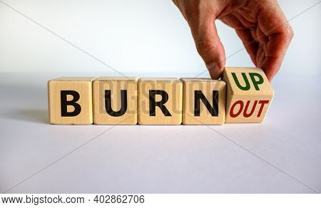 Burn Up, Not Burnout. Male Hand Flips A Wooden Cube And Changes Words 'burnout' To 'burn Up' Or Vice