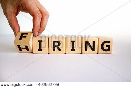 Hiring Or Firing Symbol. Businessman Hand Turns A Wooden Cube And Changes The Word 'firing' To 'hiri