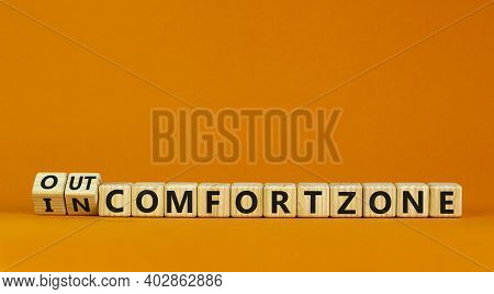Out Or In Comfort Zone Symbol. Turned Wooden Cubes And Changed Words 'in Comfort Zone' To 'out Comfo