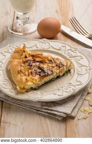 cake with spinach egg and almond flakes