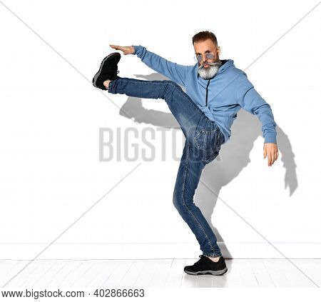 Jumping Man Happy Excited. Funny Portrait On Old Casual Male Male Model In Humorous Jump On White Ba