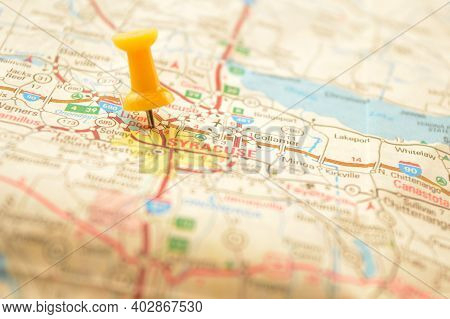 A Yellow Pin Pressed Into A Map Detailing The Point Of Interest Referring To The Place Named Syracus