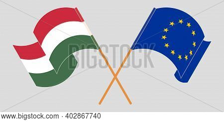 Crossed And Waving Flags Of Hungary And The Eu. Vector Illustration