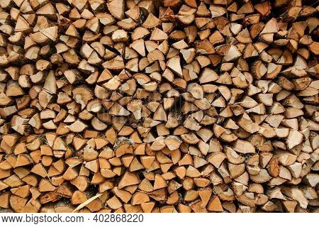 Firewood Texture Logs Rural Scene Brown Background. Pile Of Wood Logs Ready For Winter
