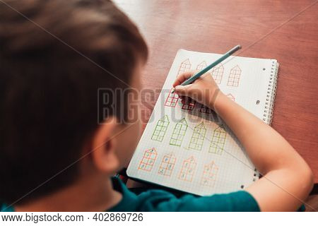 Close Up View From Above To Schoolboy Doing Math Developing Creative Exercises