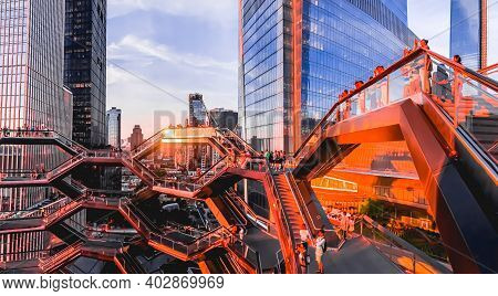 People Enjoying The View Of Midtown Manhattan Skyscrapers From The Vessel Staircase At Hudson Yards