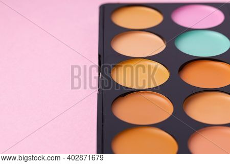 Cosmetics For Face Complexion On Pink Background