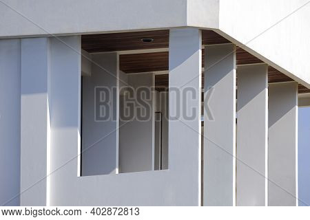 Low Angle And Perspective Side View Of Rectangle Porch Columns On Terrace Of White Modern House Buil
