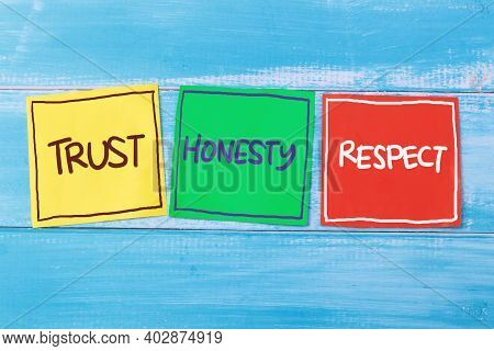 Trust Honesty Respect, Text Words Typography Written On Paper Against Wooden Background, Life And Bu
