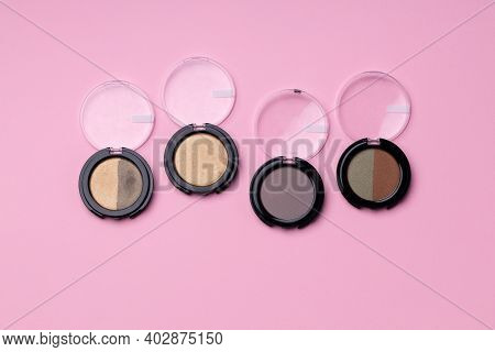 Set Of Eyeshadows Make Up Products On Pink