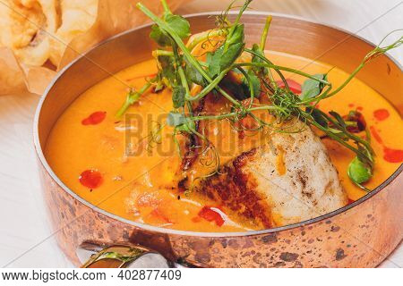 Pan Fried Halibut Garnished With Fennel Seeds And Mustard Sauce, Served With Fried Cherry Tomatoes S