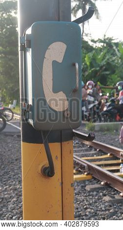 Telephone Box On A Pole On The Side Of The Train Tracks