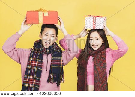Happy Asian Couple Showing The Gifts And Celebrating Chinese New Year