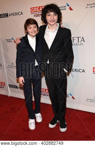 LOS ANGELES - JAN 07:  Noah Schnapp and Finn Wolfhard arrives for  2017 BAFTA Tea Party on January 07, 2017 in Beverly Hills, CA
