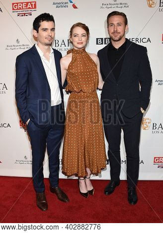 LOS ANGELES - JAN 07:  Damien Chazelle, Ryan Gosling and Emma Stone arrives for  2017 BAFTA Tea Party on January 07, 2017 in Beverly Hills, CA