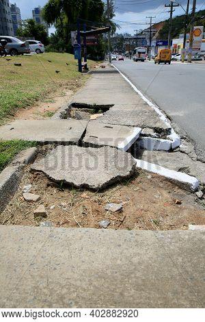Hole In The Pedestrian Sidewalk
