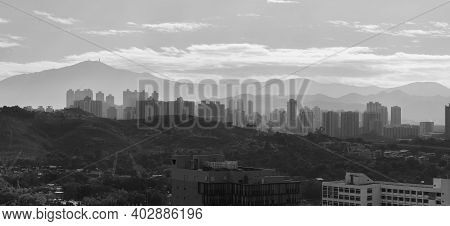 Silhouette City Skyline And Mountain. Landscape Of Hong Kong At Dawn
