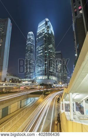 High Rise Modern Office Building In Downtown Of Hong Kong City At Night