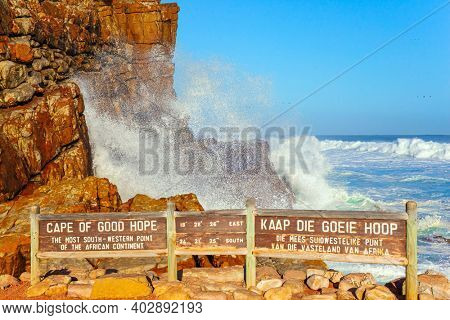 The famous Cape of Good Hope at the southern tip of the Cape Peninsula, South Africa. Powerful ocean surf. White foam of the ocean surf. Bright sunny summer February day.