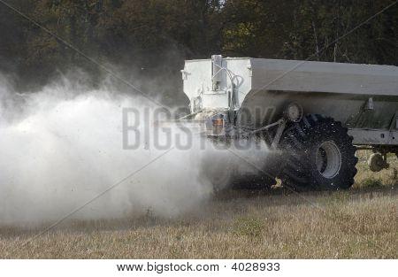 Spreading White Fertilizer