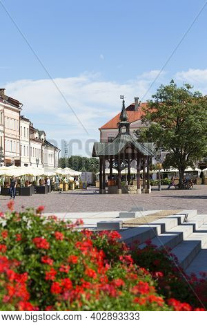 Rzeszow, Poland - August 26, 2020 : Main Market Square With Historic Tenement Houses And A Wooden Ol