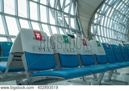 Empty Seat In Departure Lounge At Airport Terminal. Distance For One Seat Keep Distance To Protect C