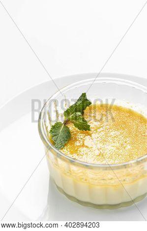 Vegan Dairy Free Organic Coconut Cream Creme Brulee Dessert On White Background
