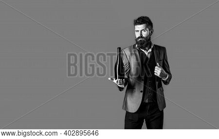 Man Holding Bottle With Champagne, Wine. Bearded Man With A Bottle Champagne Of And Glass. Black And