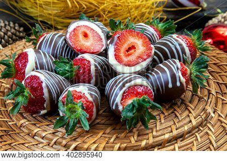 Homemade chocolate covered strawberries ready to eat with Christmas decoration