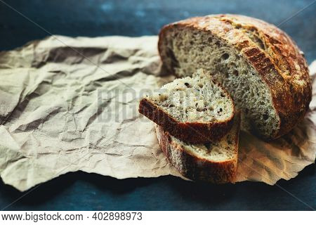 It Is A Loaf Of Fresh Crusty Bread With Cereals On Sourdough. Yeast-free Homemade Cakes Close-up. Ba
