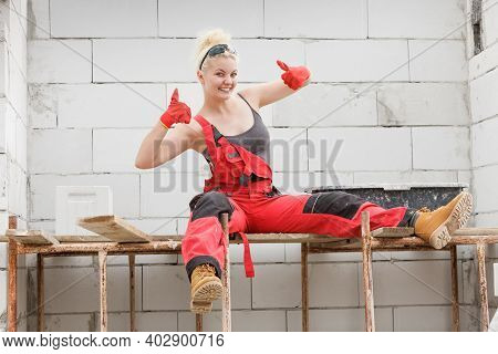 Woman Working On Home Construction Site