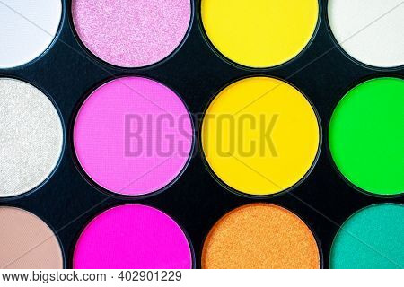 Multicolored Neon Eyeshadow Palette. Make-up. Beauty Products. Bright Colorful Beautiful Background.